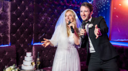 Bride and groom singing karaoke