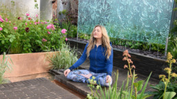 Woman meditating in a garden